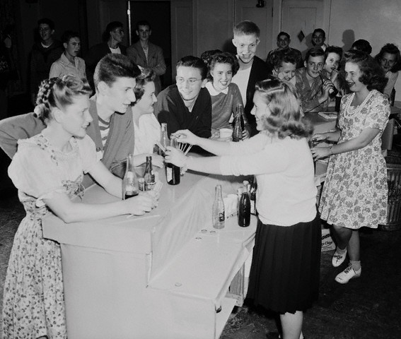 Adolescents Gather for Sodas at a Dance